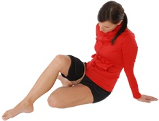 A Woman Using the King Brand ColdCure Leg Wrap