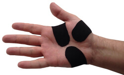 A hand that has been taped with KB Support Tape to prevent re-injury