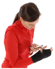 A photo of a woman wearing the King Brand® BFST® Wrist Wrap and using the included controller